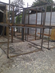 Custom steel fabricated large welded angle iron cages for marine hatchery to hold 3 tons of fish trays with hooks.jpg
