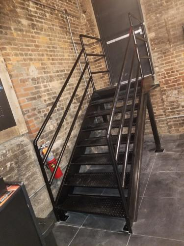 1st -diamond-plate-iron-stairs-with-piperails
