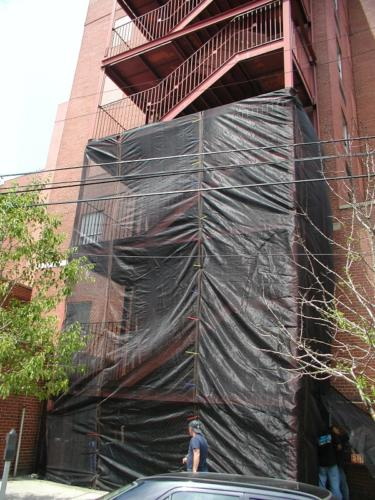 Structural commercial steel pan stair tower with structural framing