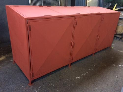 Primed steel trash box.